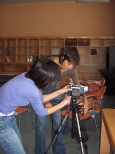 Chai-Ying Lee & Ana Camila Amorim filming in the library.