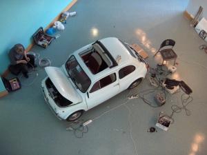 Eduardo Brambilla fixing the Fiat 500 exhibit.